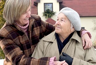 Image: A woman caring for her elderly neighbour