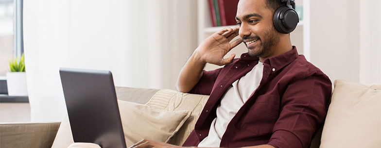 Image: man listening to audio on his computer