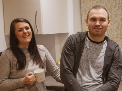 image: Jon and Mollie in the kitchen of their new home