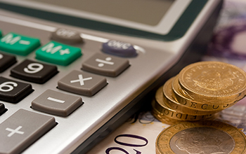 image: a photo of a calculator and some money