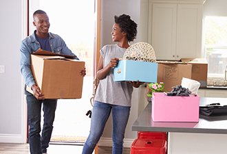 image: a couple packing when moving home