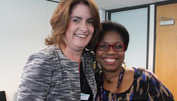 image: 2 female Optivo staff members smiling
