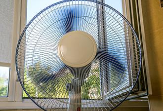 Image: Fan infront of window